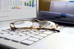 White aptop with glasses. Royalty Free Stock Images