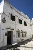 White arabic house in Tangier,Morocco. Vertical photo of white arabic house with lantern and windows in Tangier,Morocco with blue skyline Stock Photos