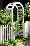 White arbor in a garden Stock Photography