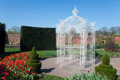 White arbour in a large garden Royalty Free Stock Photo
