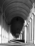 White arcades of a staircase with black and white effect. White arches and the staircase leading to a sanctuary in Vicenza Italy with black and white effect Stock Photography