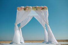 Wedding white arch on the beach. stock photos