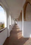 White arch corridor. With terracotta tile flooring Royalty Free Stock Images