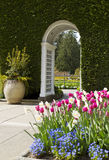 White Arch leading to garden Royalty Free Stock Images