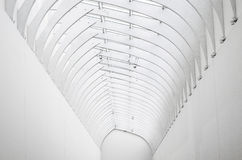 White arch of steel and glass, view far perspective. Stock Photography