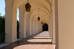 White arches with hanging lights Royalty Free Stock Photos