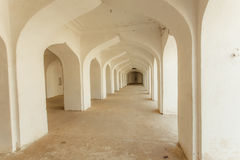 White arches in indian house with long corridor inside. Old building in India. White arches in indian house with long corridor inside. Old building in India Stock Photos
