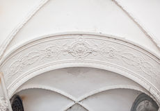 White architectural arch at the entrance to the church.  Stock Images