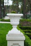 White architectural vase on a pedestal in the park Stock Photo