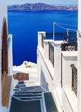 White architecture with steps leading down to the sea on Santorini island, Greece. Beautiful landscape with sea view. Stock Images