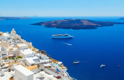 White architecture on Santorini island, Greece. Beautiful landscape with ship and sea view Royalty Free Stock Photos