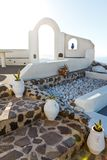 White architecture on Santorini island, Greece. Beautiful old white ortodox church in sunny day with blue sky in Oia on Santorini island. Santorini is romantic Royalty Free Stock Photography