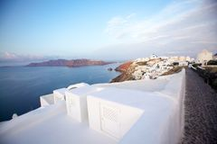 White architecture on Santorini island, Greece. Beautiful old white ortodox church in sunny day with blue sky in Oia on Santorini island. Santorini is romantic Stock Photos