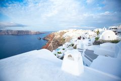 White architecture on Santorini island, Greece. Beautiful old white ortodox church in sunny day with blue sky in Oia on Santorini island. Santorini is romantic Royalty Free Stock Photo