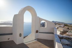 White architecture on Santorini island, Greece. Beautiful old white ortodox church in sunny day with blue sky in Oia on Santorini island. Santorini is romantic Stock Photography