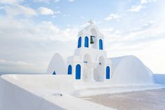 White architecture on Santorini island, Greece. Beautiful old white ortodox church in sunny day with blue sky in Oia on Santorini island. Santorini is romantic Stock Images