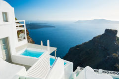 White architecture on Santorini island, Greece. Beautiful summer landscape with sea view at sunset Stock Image