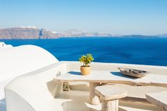 White architecture on Santorini island, Greece. Beautiful terrace with sea view Stock Photography