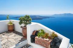 White architecture on Santorini island, Greece. Beautiful terrace with sea view. White architecture on Santorini island, Greece Royalty Free Stock Images