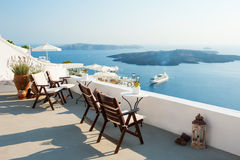 White architecture on Santorini island, Greece. Beautiful terrace, sea view Royalty Free Stock Photo