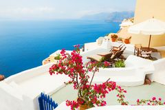 White architecture on Santorini island, Greece. Beautiful terrace with sea view Royalty Free Stock Images