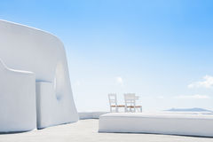 White architecture on Santorini island, Greece. Beautiful terrace with two chairs Stock Image