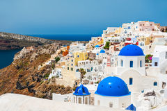 White architecture on Santorini island, Greece. Church with blue domes in Oia town. White architecture on Santorini island, Greece Royalty Free Stock Photography