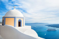 White architecture on Santorini island, Greece. Church in Fira town. Beautiful landscape with sea view Royalty Free Stock Image