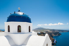 White architecture on Santorini island, Greece. The Church in Imerovigli village. White architecture on Santorini island, Greece. Beautiful view on the sea Royalty Free Stock Photography