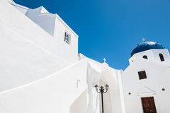 White architecture on Santorini island, Greece. The Church in the town of Imerovigli. White architecture on Santorini island, Greece Royalty Free Stock Photography