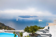White architecture on Santorini island, Greece. Morning mist on Santorini island, Greece. Beautiful landscape with sea view Royalty Free Stock Images