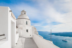 White architecture on Santorini island, Greece. Old church in Fira town. White architecture on Santorini island, Greece.  Beautiful landscape with sea view Royalty Free Stock Photo