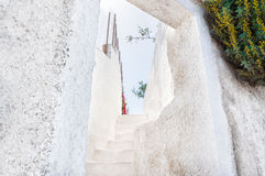White architecture on Santorini island, Greece. Old street in the Fira town. White architecture on Santorini island, Greece Royalty Free Stock Image
