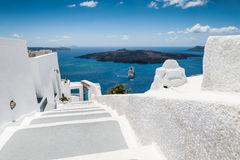 White architecture on Santorini island, Greece. Stairs leading down to the sea. White architecture on Santorini island, Greece. Beautiful view on the sea Royalty Free Stock Photography