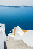 White architecture on Santorini island, Greece. Stairs to the sea. Beautiful landscape with sea view. Selective focus Royalty Free Stock Images