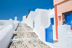 White architecture on Santorini island, Greece. Street in Fira town. White architecture on Santorini island, Greece. Beautiful summer landscape Royalty Free Stock Images