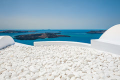 White architecture on Santorini island, Greece. Terrace in the hotel with decorative white stones. White architecture on Santorini island, Greece. Beautiful Royalty Free Stock Photos