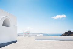 White architecture on Santorini island, Greece. Two chairs on the terrace with sea view. White architecture on Santorini island, Greece Royalty Free Stock Photos