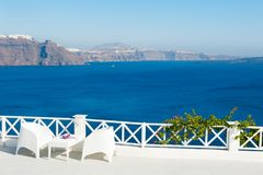 White architecture on Santorini island, Greece. Beautiful terrace with sea view Stock Photos