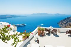 White architecture on Santorini island, Greece. Beautiful terrace with sea view Stock Image