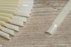 White arificial nails stock images