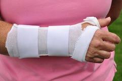 White Arm Brace. A White Plastic Arm Brace Royalty Free Stock Photo