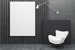 White armchair and a poster, black Stock Photography