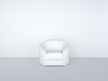 White armchair in white room Royalty Free Stock Image