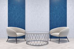 White armchairs in a blue and gray room Stock Photography