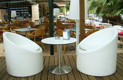 White armchairs in cafeteria. An interior of modern cafe \restaurant with white armchairs Royalty Free Stock Photography