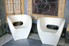 White armchairs on marble Royalty Free Stock Photo