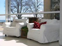 White Armchairs by the Sea. 2 white armchairs in a light room by the sea Stock Photography