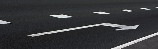 White arrow on the asphalt Stock Image
