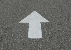 White Arrow on Asphalt Royalty Free Stock Photo